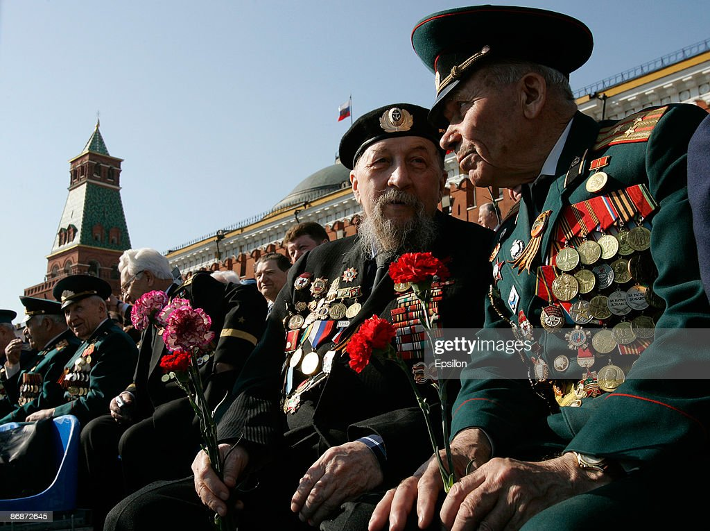Russian WWII veterans chat during the nation's Victory Day parade in commemoration of the end of WWII held at the Red Square on May 9, 2009 in Moscow, Russia. The ceremony commemorates Victory Day of May 9, 1945 on which the World War II Allies' achieved victory over and unconditional surrender of Nazi Germany's armed forces.