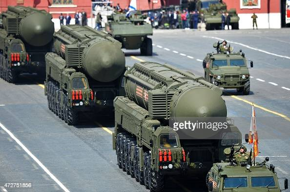 A Russian Yars RS24 intercontinental ballistic missile system drives during the Victory Day military parade in Moscow on May 9 2015 Russian President...