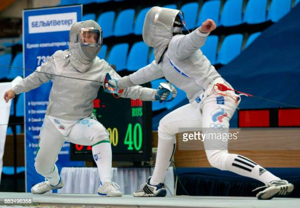 Russian Yelena Netchayeva fights with Hungarian Orsolya Nagy during the final team match of Fencing Euro Championship in Moscow 06 July 2002 Russia...