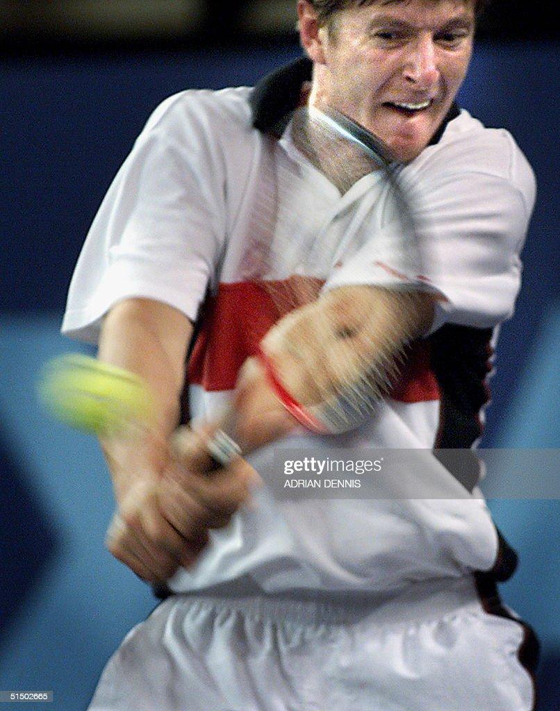 Russian Yevgeny Kafelnikov hits 25 February 2000 a