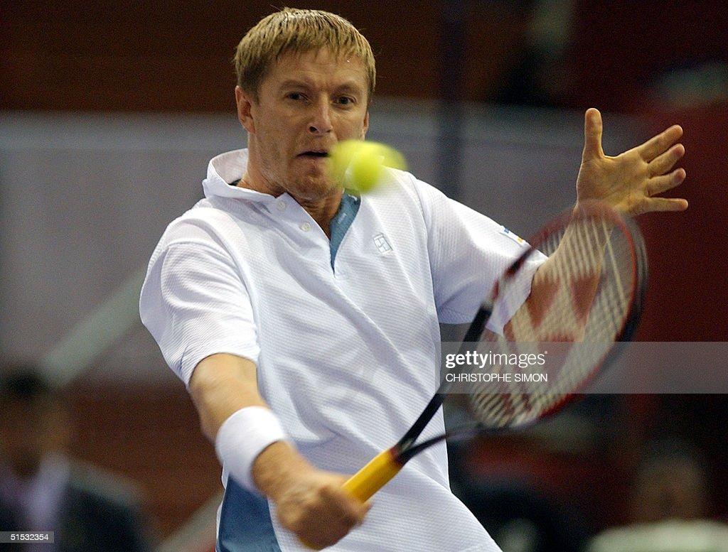 Russian Yevgeny Kafelnikov returns a ball to Spain