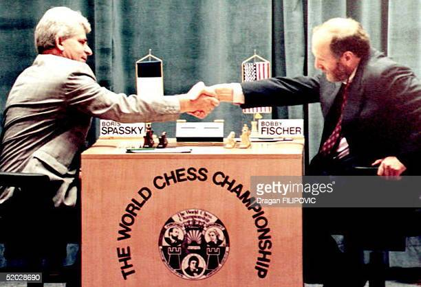 Russianborn chess master Boris Spassky shakes hands with US Bobby Fischer at the beginning of their first match in the Hotel Maestral 02 September...