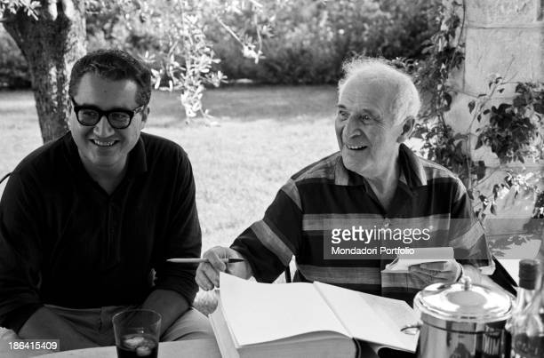 Russianborn French painter Marc Chagall smiling and holding a notepad The actor sits next to Italian journalist Guido Gerosa SaintPaul de Vence...
