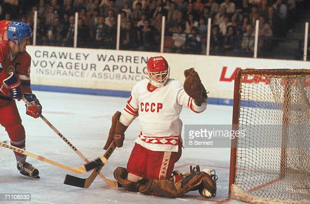 Russianborn professional hockey player Vladislav Tretiak goaltender for the Soviet team kneels in front of the goal at the 1981 Canada Cup Canada...
