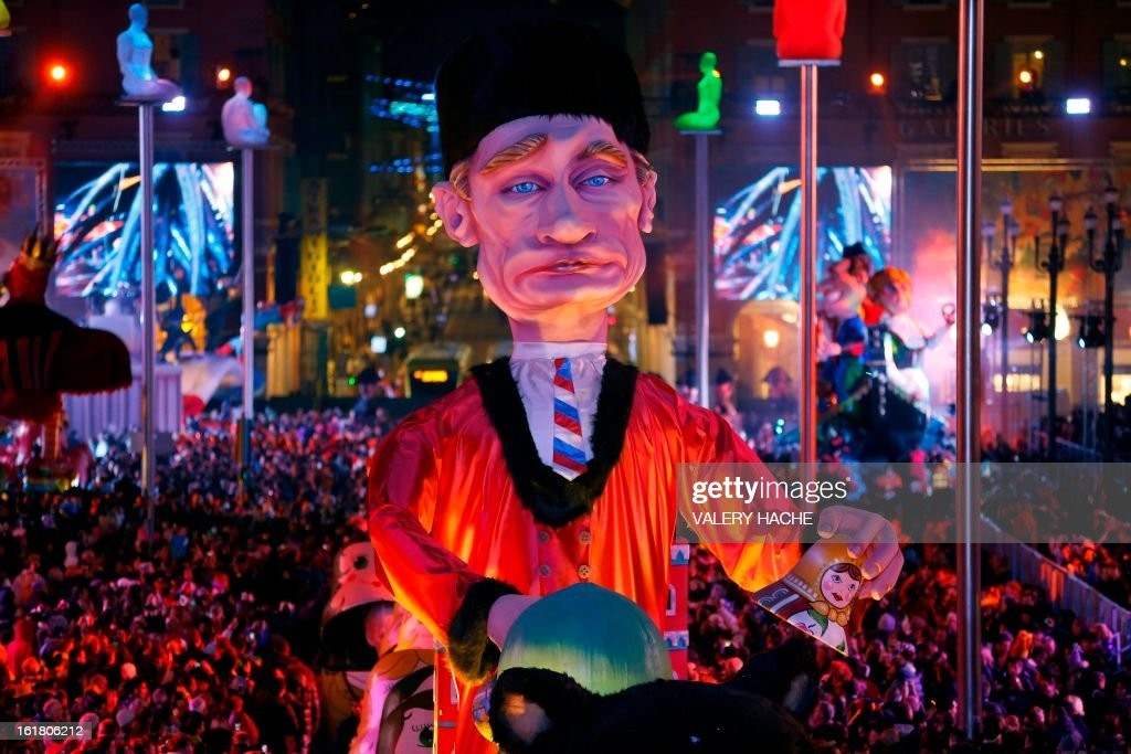 A Russian-inspired float, featuring Russian President Vladimir Putin, parades on February 16, 2013 during carnival in the southeastern French city of Nice. The carnival, which ends on March 6, celebrates the King of the Five Continents for its 140th anniversary. AFP PHOTO / VALERY HACHE
