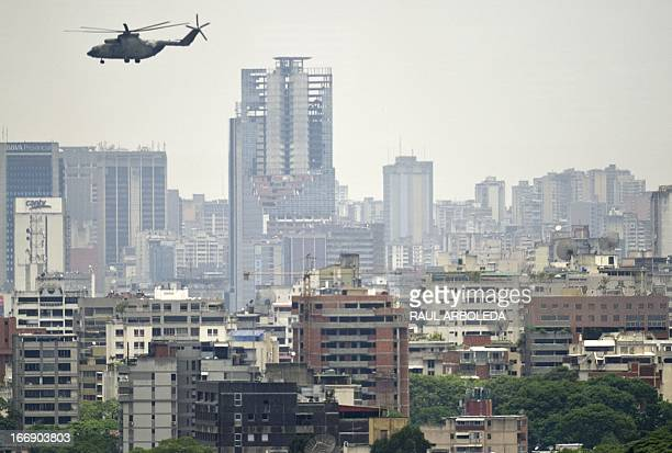 A Russianmade Mi26 heavy transport helicopter from the Venezuelan Army overflies Caracas on April 18 2013 Venezuelan President Nicolas Maduro...