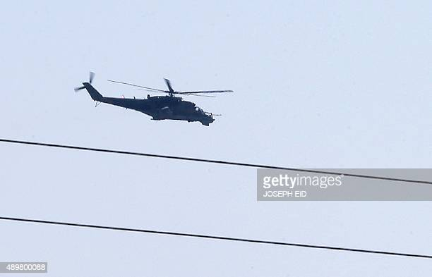 A Russianmade Mi35 Hind attack helicopter hovers over Latakia airport in the governmentcontrolled coastal Syrian city on September 24 2015 AFP...