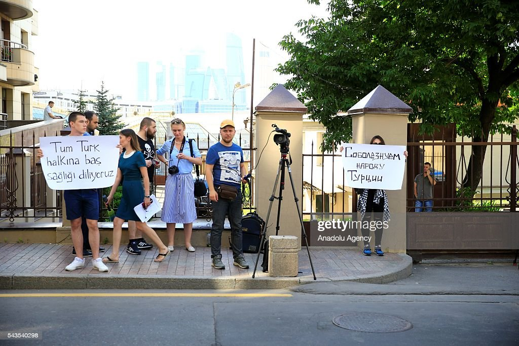 Russians hold banners reading in 'Our condolences to Turkey' outside the Turkish Embassy in Moscow, Russia on June 29, 2016. The death toll in Istanbuls airport terror attack has risen to 41, the regional governors office said Wednesday.