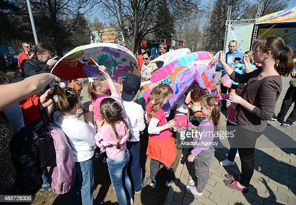 Russians picnic at the Tsvetnoy Ticino park in Moscow the day after traditional foods blessed for Easter as temperature hits 20 degree in the capital...