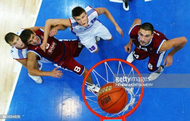 Russians Serguey Monia and Andrei Kirilenko and N Prk cin and Dragan Bagaric of Croatia looks on as Russia scores during their 1/8final at the...