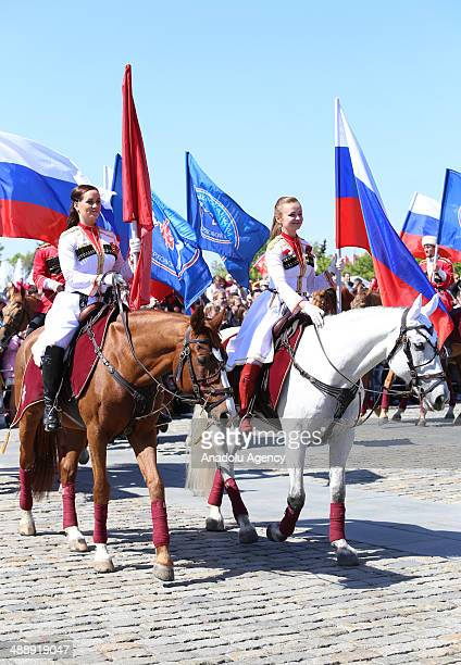 Russians wearing traditional costume ride a horse at Moscow's Victory Park during the celebrations of Victory Day also known '9 may victory' which...