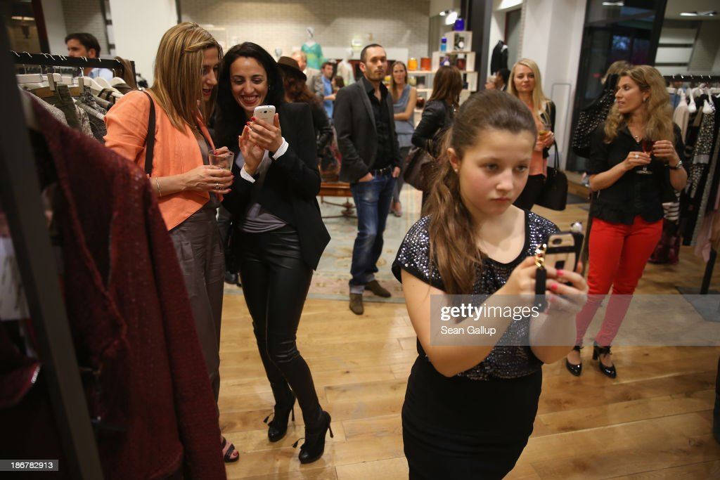 Russian-speaking guests listen to a singer peforming as they attend the 'Russian Shopping Night' at the F95 fashion store on May 7, 2013 in Berlin, Germany. According to statistics published in October of 2013, 7.2 million foreigners were living in Germany by the end of 2012, which is the highest number ever recorded. Of those 80% are from countries in the European Union, while the rest come primarily from Turkey, Russia, the former Soviet states and Arab countries.