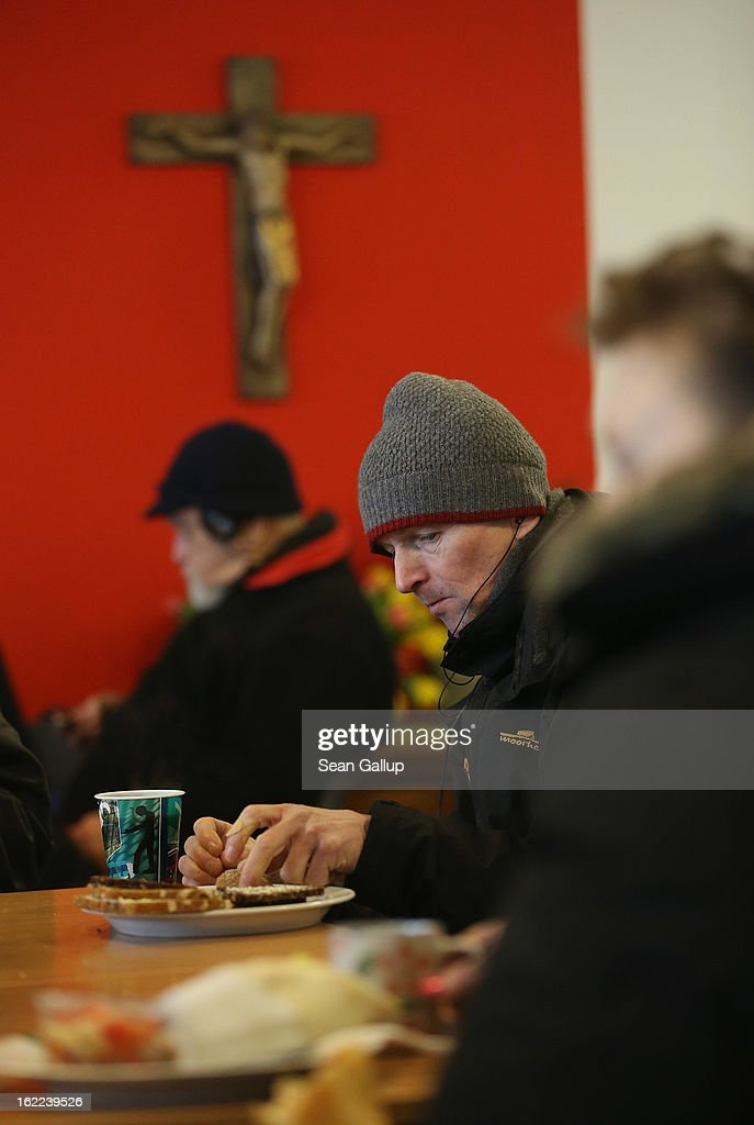 A Russian-speaking man eats a free lunch with other visitors, many of them homeless, at the Bahnhofsmission Protestant charity facility at Zoo train station on February 20, 2013 in Berlin, Germany. The Bahnhofsmission feeds up to 600 needy men and women every day, up from 400 only three years ago. Approximately 60% of the visitors are from Eastern Europe, many of them workers in low-paying jobs who became unemployed and ran out of money. Dieter Puhl, who runs the Bahnhofsmission, says he is seeing a steady increase in the number of visitors, especially among older Germans whose pensions are insufficient for them to make ends meet. Poverty in Germany, defined as someone who makes less than 60% of the median wage, has risen steadily in recent years, and according to statistics 14% of people in Germany lived below the poverty line in 2010. Both poverty and pensions that have not kept up with the rising cost of living will be contested topics in federal elections scheduled later for this year.