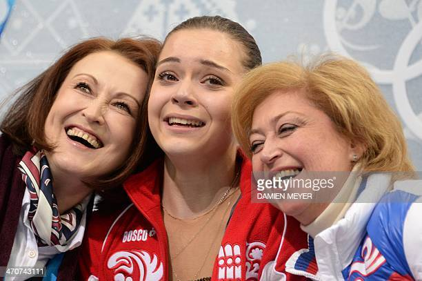 Russia's Adelina Sotnikova reacts in the kiss and cry zone during the Women's Figure Skating Free Program at the Iceberg Skating Palace during the...