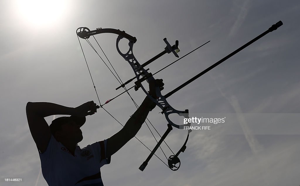 Russia's Albina Loginova competes during the Archery World Cup women's final match at the Trocadero gardens in Paris on September 21, 2013. Damsbo won the event ahead of Gellenthien and Pagni. AFP PHOTO / FRANCK FIFE