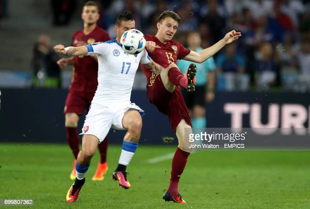 Russia's Aleksandr Golovin and Slovakia's Marek Hamsik battle for the ball