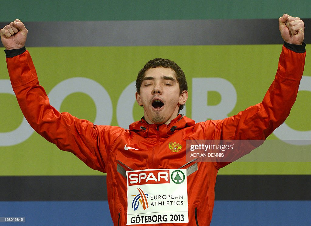 Russia's Aleksandr Menkov celebrates on the podium after winning the Long Jump Men's Final at the European Indoor Athletics Championships in Gothenburg, Sweden, on March 3, 2013