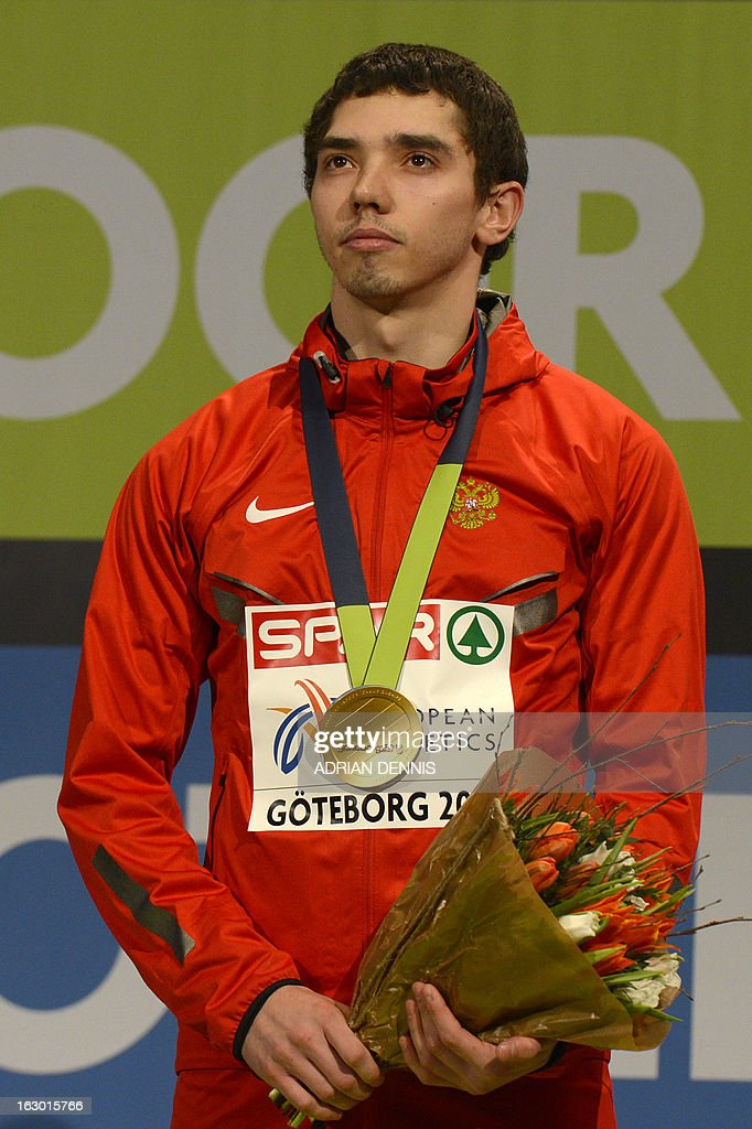 Russia's Aleksandr Menkov stands with his gold medal on the podium after winning the Long Jump Men's Final at the European Indoor Athletics Championships in Gothenburg, Sweden, on March 3, 2013