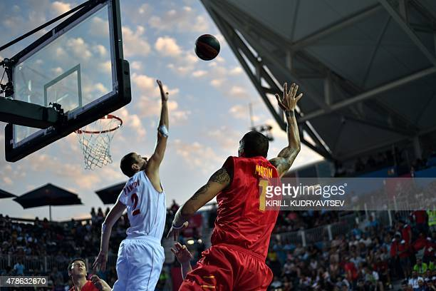 Russia's Aleksandr Pavlov vies with Spain's Jose Ignacio Martin Monzon in the Men's 3x3 basketball final match between Russia and Spain at the 2015...