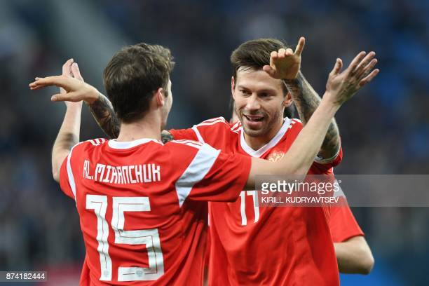 Russia's Aleksey Miranchuk celebrates with Fedor Smolov after scoring a goal during an international friendly football match between Russia and Spain...
