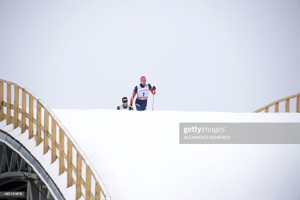 Russia's Alexander Bessmertnykh (R) competes ahead of France's <a gi-track='captionPersonalityLinkClicked' href=/galleries/search?phrase=Jean-Marc+Gaillard&family=editorial&specificpeople=4137578 ng-click='$event.stopPropagation()'>Jean-Marc Gaillard</a> (L) during the men's skiathlon 15 km classic + 15 km free race of the FIS Cross-country World Cup on January 25, 2015 in Rybinsk. Russia's Maxim Vylegzhanin won ahead of silver medalist Switzerland's Dario Cologna and bronze medalist Finland's Matti Heikkinen.