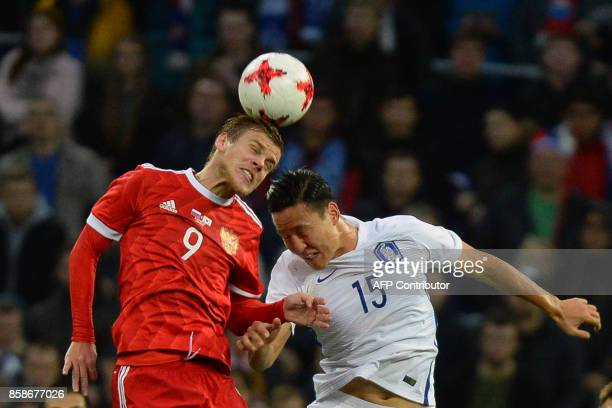 Russia's Alexander Kokorin and South Korea's Kwon Kyungwon vie for the ball during an international friendly football match between Russia and South...