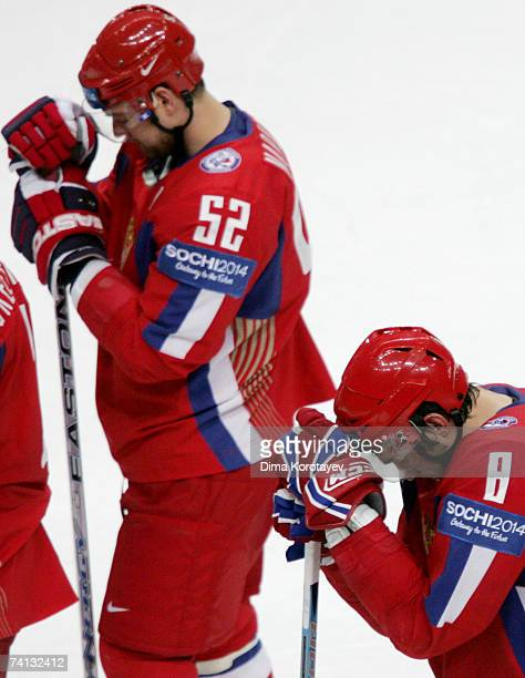 Russia's Alexander Ovechkin and Andrey Markov react after losing the IIHF World Ice Hockey Championship semifinal match between Russia and Finland at...