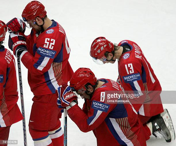 Russia's Alexander Ovechkin Andrey Markov and Ivan Nepryaev react after losing the IIHF World Ice Hockey Championship semifinal match between Russia...