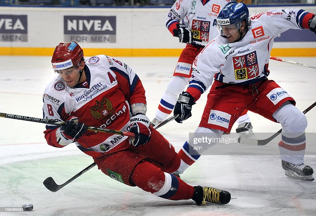 Russia's Alexander Ovechkin (L) fights for the puck with Czech Republic's David Krejci on December 15, 2012 during a Channel One Cup hockey match against the Czech Republic, an event of the Euro Hockey Tour, in Moscow. FARISEYEV