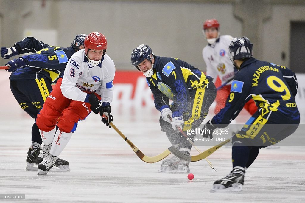 Russia's Alexander Tyukavin (2nd L) fights for the ball with Kazakhstan (from L) Alexander Nasonov, Vyacheslav Bronnikov and Dmitriy Zavidovskiy during the Bandy World Championship match between Russia and Kazakhstan in Vanersborg, Sweden, on January 27, 2013.