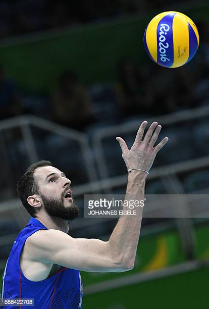 Russia's Alexander Volkov serves the ball during the men's qualifying volleyball match between Russia and Egypt at the Maracanazinho stadium in Rio...