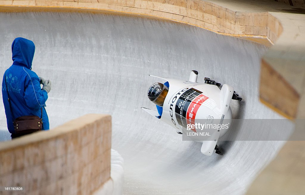 Russia's Alexander Zubkov takes part in the first run of the Men's Bobsleigh competition in the FIBT Bob & Skeleton World Cup at the Sanki Sliding Centre, some 50 km from Russia's Black Sea resort of Sochi, on February 16, 2013. With a year to go until the Sochi 2014 Winter Games, construction work continues as tests events and World Championship competitions are underway.