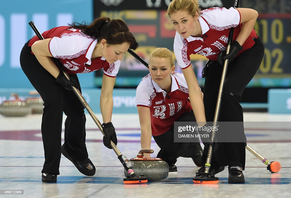 Russia's Alexandra Saitova throws the stone during the Women's Curling Round Robin Session 6 match South Korea vs Russia at the Ice Cube Curling...