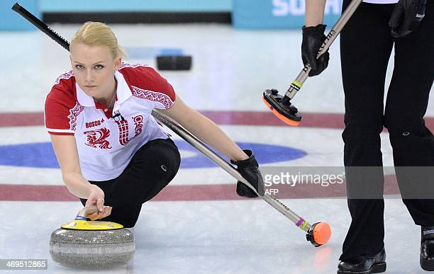 Russia's Alexandra Saitova throws the stone during the Women's Curling Round Robin Session 9 between Russia and Canada at the Ice Cube Curling Center...