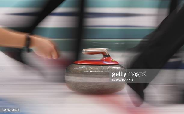 TOPSHOT Russia's Alina Kovaleva releases the stone during the gold medal match against Canada at the Women's Curling World Championships in Beijing...