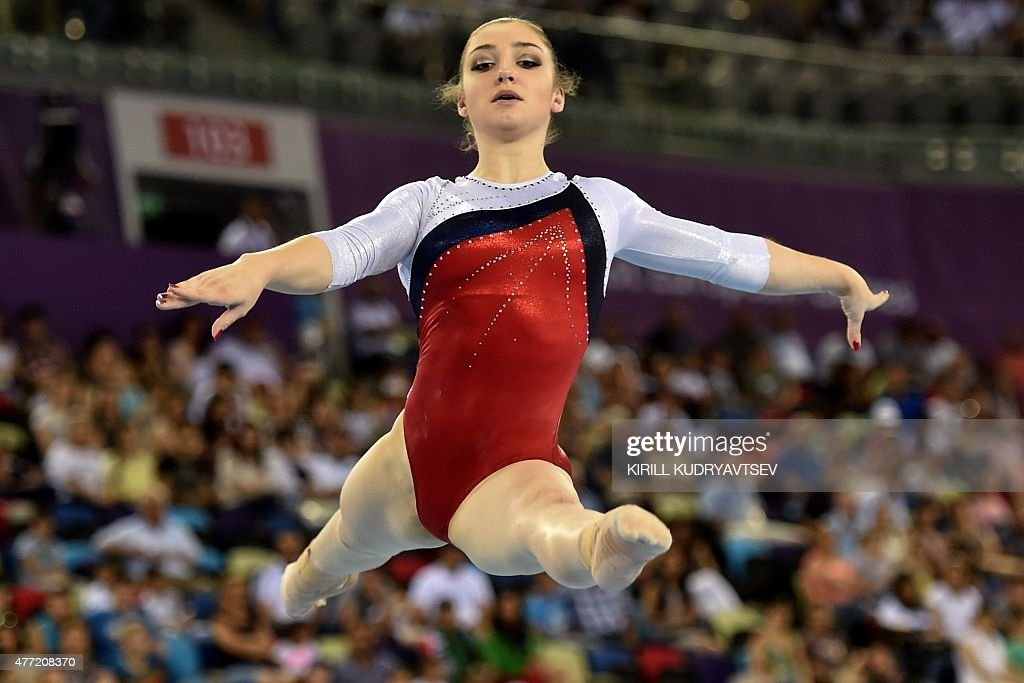 Russia's Aliya Mustafina competes on the floor during the women's team final of the artistic gymnastics event at the 2015 European Games in Baku on...