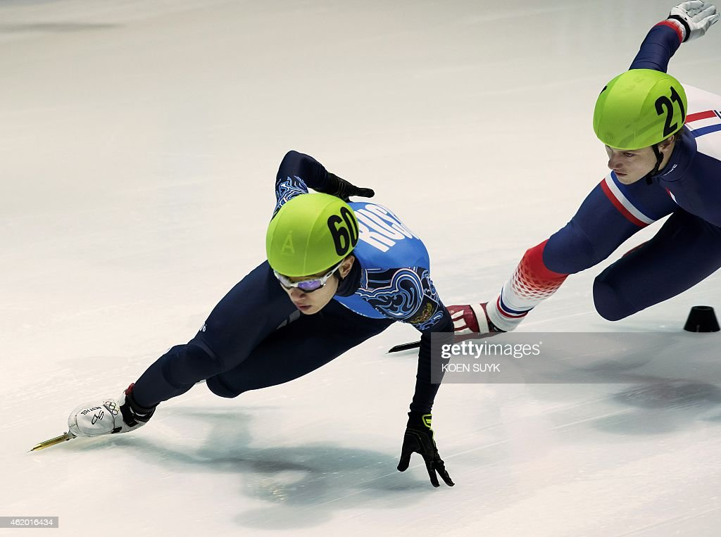 Russia's An Victor (L) and France's Sebastien Lepape compete in the 1500m of the ISU European Short Track Speed Skating Championships in Dordrecht on January 23, 2015.