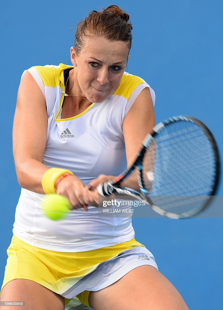Russia's Anastasia Pavlyuchenkova hits a return against Ukraine's Lesia Tsurenko during their women's singles first round match on day two of the Australian Open tennis tournament in Melbourne on January 15, 2013.