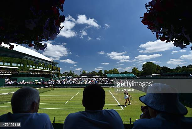 Russia's Anastasia Potakova plays against US player Francesca Di Lorenzo during their girls singles first round match on day six of the 2015...