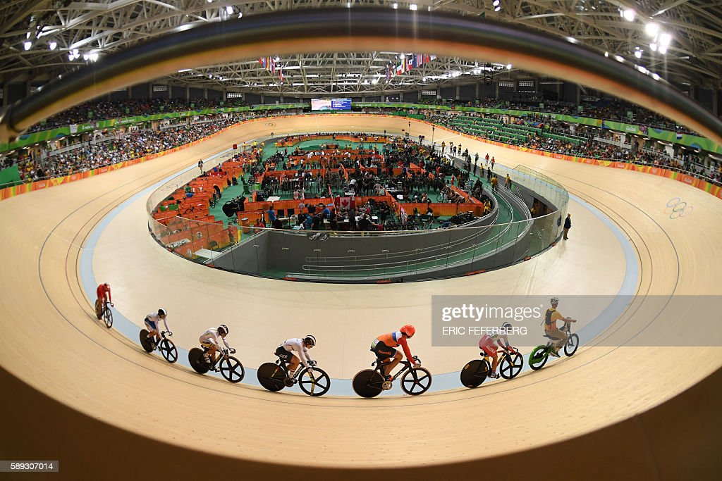 TOPSHOT - (From 2nd R) Russia's Anastasiia Voinova, Netherlands' Elis Ligtlee, Germany's Kristina Vogel, Colombia's Martha Bayona Pineda, South Korea's Lee Hyejin and China's Zhong Tianshi compete in the women's Keirin second round track cycling event at the Velodrome during the Rio 2016 Olympic Games in Rio de Janeiro on August 13, 2016. / AFP / Eric FEFERBERG
