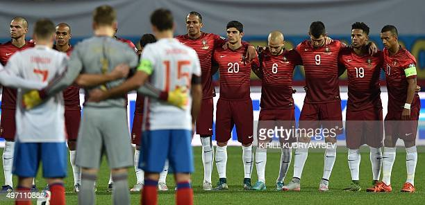 Russia's and Portugal's players observe a minute of silence in honor of victims of the attacks that left at least 120 dead in Paris prior to the...