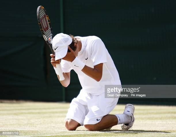 Russia's Andrey Kuznetsov celebrates beating USA's Jordan Cox in the Boy's Singles Final during the Wimbledon Championships 2009 at the All England...