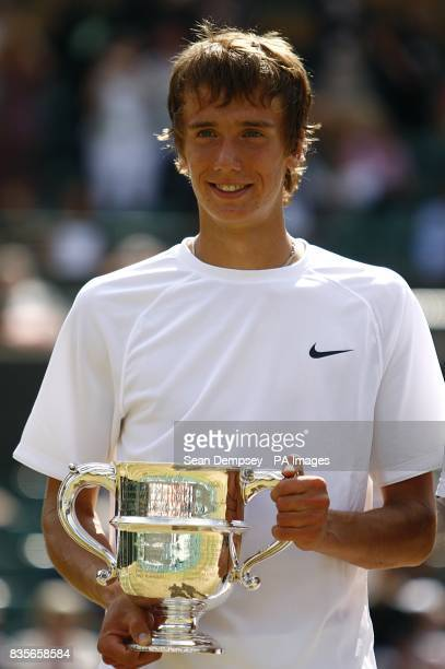 Russia's Andrey Kuznetsov celebrates with the trophy after beating USA's Jordan Cox in the Boy's Singles Final during the Wimbledon Championships...