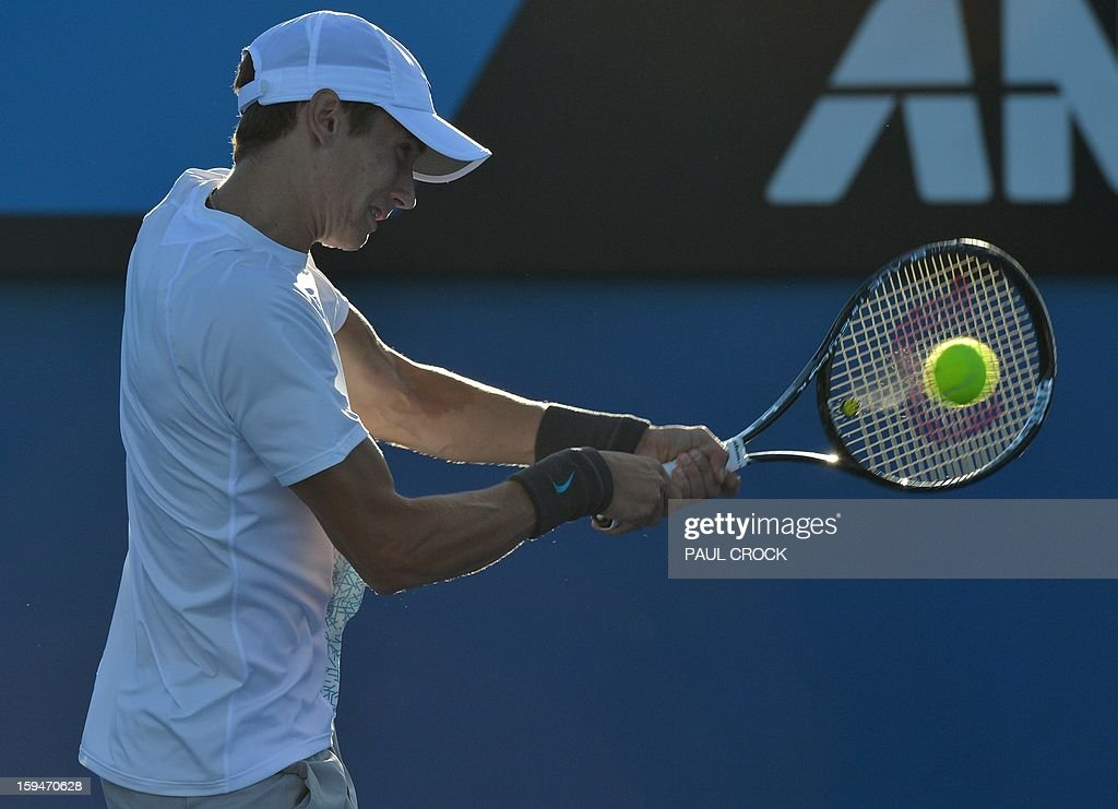 Russia's Andrey Kuznetsov hits a return against Argentina's Juan Monaco during their men's singles first round match on day one of the Australian Open tennis tournament in Melbourne on January 14, 2013.