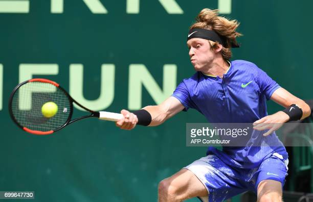 Russia's Andrey Rublev in action against Russia's Mikhail Youzhny during the ATP tournament tennis match in Halle western Germany on June 22 2017 /...