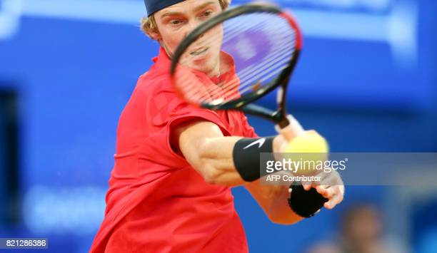 Russia's Andrey Rublev returns the ball during the Umag 2017 ATP 250 tennis final match between Russia's Andrey Rublev and Italia's Paolo Lorenzi in...