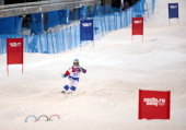 Russia's Andrey Volkov competes in qualifying of the men's moguls at Rosa Khutor Extreme Park during the Winter Olympics in Sochi Russia Monday Feb...