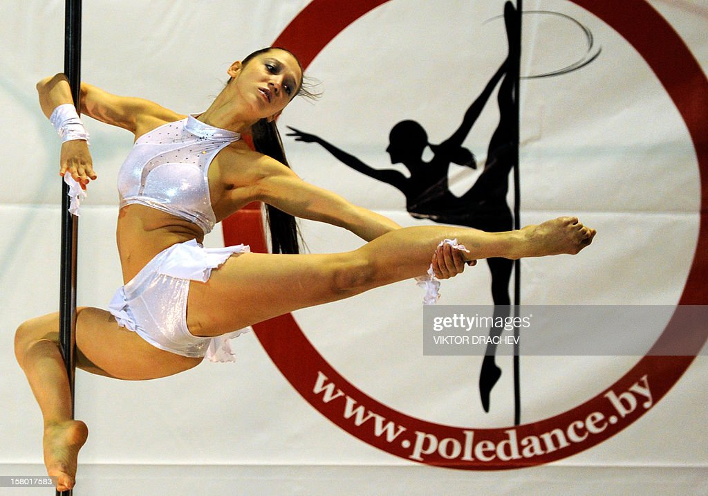 Russia's Anna Chegarina performs at Belarus open cup tournament for sport pole dance in Minsk, on December 8, 2012.