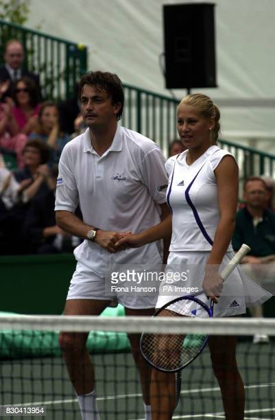 Russia's Anna Kournikova and France's Henri Leconte shake hands during the Duke of York's NSPCC Tennis Challenge at Buckingham Palace