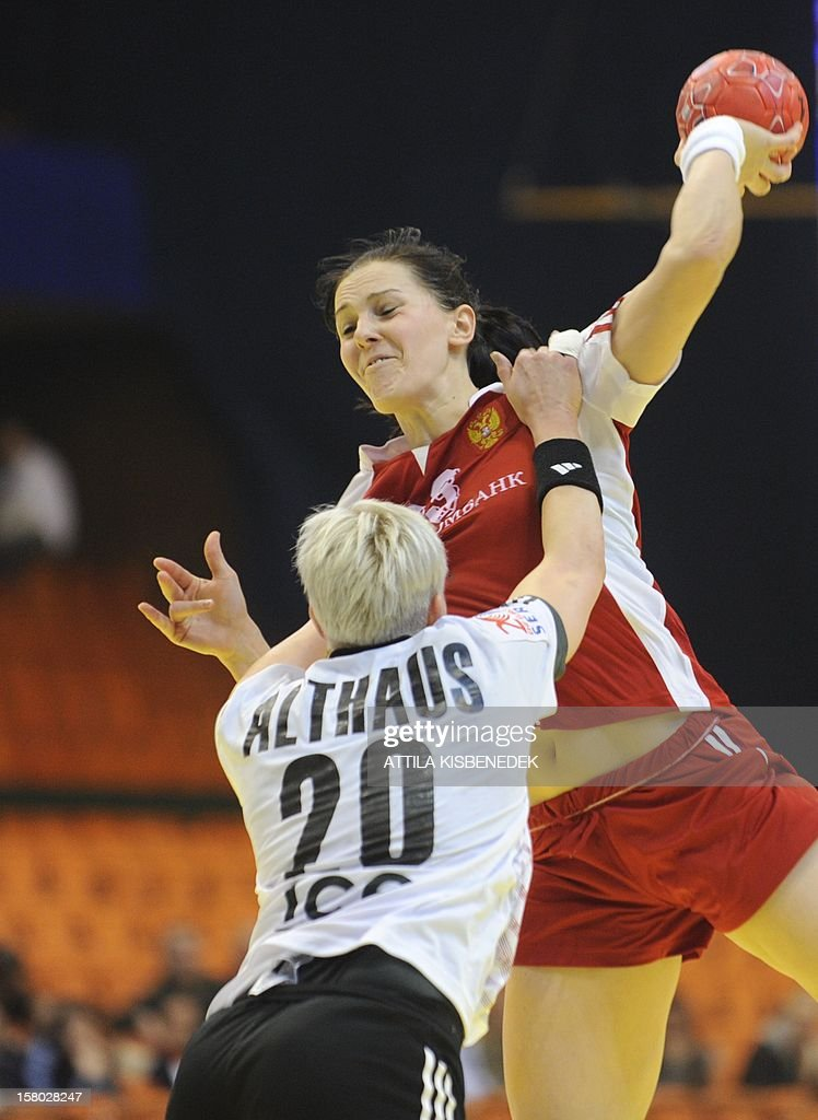 Russia's Anna Punko (R) tries to shoot despite of Germany's Anja Althaus (L) on December 9 , 2012 during their women's 2012 EHF European Handball Championship Group II match at the Novi Sad arena.